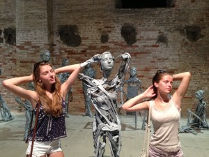 "Daughter Emma and niece Carla pose among Pawel Althamers ""Venetians"" in the Arsenale"